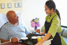 Caregiver serve a foods to an old Man
